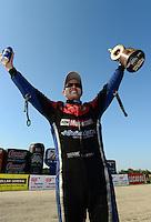 Sept. 23, 2012; Ennis, TX, USA: NHRA funny car driver Bob Tasca III celebrates after winning the Fall Nationals at the Texas Motorplex. Mandatory Credit: Mark J. Rebilas-
