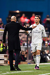Cristiano Ronaldo of Real Madrid shakes hands with coach Zinedine Zidane during their La Liga match between Atletico de Madrid and Real Madrid at the Vicente Calderón Stadium on 19 November 2016 in Madrid, Spain. Photo by Diego Gonzalez Souto / Power Sport Images