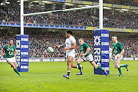 Manu Tuilagi of England and Keith Earls of Ireland chase down a chip ahead in the in-goal area during the RBS 6 Nations match between Ireland and England at the Aviva Stadium, Dublin on Sunday 10 February 2013 (Photo by Rob Munro)