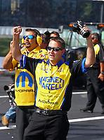Jun. 1, 2014; Englishtown, NJ, USA; Crew members celebrate as NHRA pro stock driver Jeg Coughlin Jr wins the Summernationals at Raceway Park. Mandatory Credit: Mark J. Rebilas-