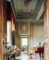 The music room doubles as a cocktail lounge, while neo-classical murals grace the walls and ceiling
