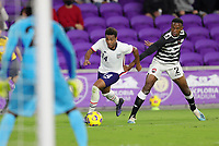 ORLANDO CITY, FL - JANUARY 31: Jonathan Lewis #14 of the United States moves with the ball during a game between Trinidad and Tobago and USMNT at Exploria stadium on January 31, 2021 in Orlando City, Florida.