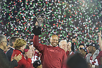 PASADENA, CA - January 1, 2013: Stanford Head Coach David Shaw holds up the Rose Bowl Trophy after the Stanford Cardinal vs the Wisconsin Badgers in the 2013 Rose Bowl Game in Pasadena, California. Final score Stanford 20, Wisconsin 14.
