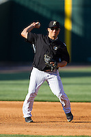 Carlos Sanchez (13) of the Charlotte Knights makes a throw to first base during infield practice prior to the game against the Gwinnett Braves at BB&T Ballpark on April 16, 2014 in Charlotte, North Carolina.  The Braves defeated the Knights 7-2.  (Brian Westerholt/Four Seam Images)