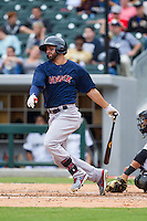 Deven Marrero (29) of the Pawtucket Red Sox follows through on his swing against the Charlotte Knights at BB&T Ballpark on August 10, 2014 in Charlotte, North Carolina.  The Red Sox defeated the Knights  6-4.  (Brian Westerholt/Four Seam Images)