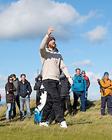 1st October 2021; Kingsbarns Golf Links, Fife, Scotland; European Tour, Alfred Dunhill Links Championship, Second round; Tommy Fleetwood of England checks the wind while walking in the rough on the fifth hole at Kingsbarns Golf Links