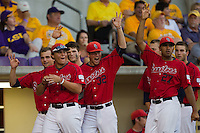 Stony Brook Seawolves players celebrate scoring another run during the NCAA Super Regional baseball game against LSU on June 10, 2012 at Alex Box Stadium in Baton Rouge, Louisiana. Stony Brook defeated LSU 7-2 to advance to the College World Series. (Andrew Woolley/Four Seam Images)