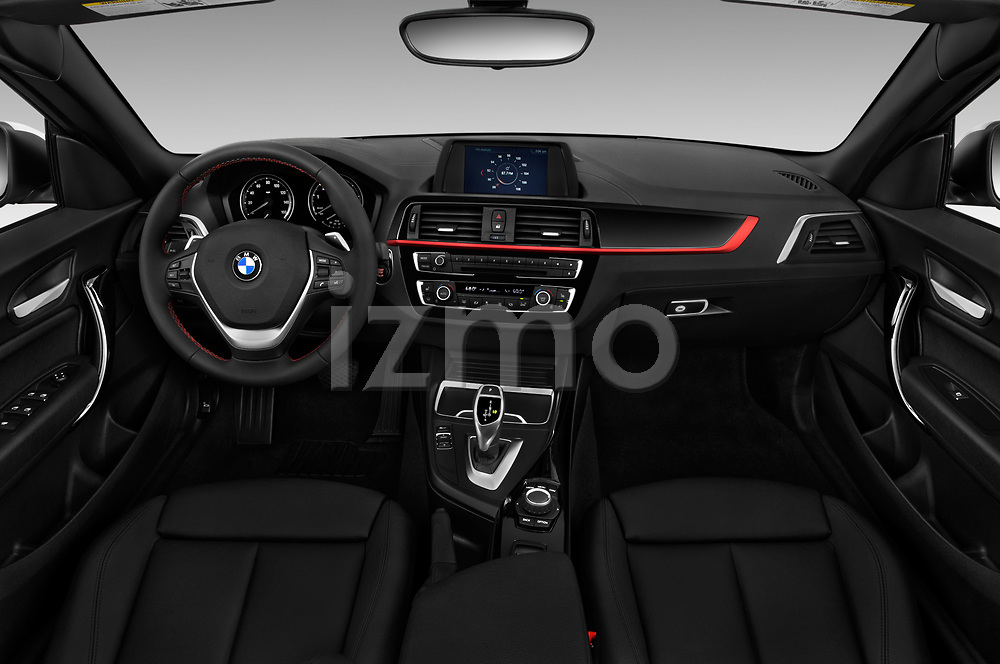 Stock photo of straight dashboard view of a 2019 BMW 2 Series 230i Sport Line 2 Door Convertible