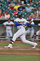 Tennessee Smokies right fielder Jorge Soler #21 swings at a pitch during a game against the Jacksonville Suns at Smokies Park July 10, 2014 in Kodak, Tennessee. The Suns defeated the Smokies 6-5. (Tony Farlow/Four Seam Images)