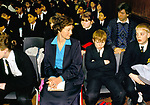 Head teacher Secondary School 1990s UK. Morning assembly with children sitting amongst them, at Greenford High School, Middlesex 1990  <br /> <br /> HEAD TEACHER MRS OLIVER,