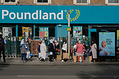 Bus stop queue outside a Poundland store, Kilburn, London.