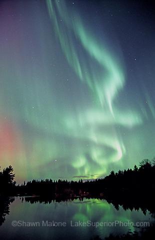 "the ""green genie"" aurora over Cataract Basin, Escanaba River, Gwinn MI. Art on the Rocks Poster award winner 2007"