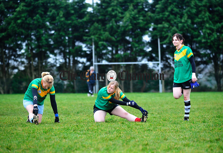 Kilmihil's Mairead Nugent, Edel Conway and Lida Russell during training at the weekend. Photograph by Declan Monaghan