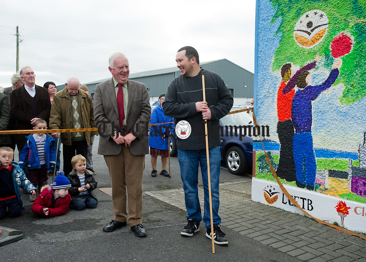Christy Curtin, founder member and treasurer of The West Clare Resource Centre, with Enda Moloney, co-ordinator Youthreach at the launch of a wall mural to mark the twentieth anniversary of the West Clare Resource Centre in Miltown Malbay. Photograph by John Kelly.