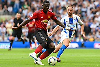 Eric Bailly of Manchester United (3) and Glenn Murray of Brighton & Hove Albion (17) challenge for the ball  during the Premier League match between Brighton and Hove Albion and Manchester United at the American Express Community Stadium, Brighton and Hove, England on 19 August 2018. Photo by Edward Thomas / PRiME Media Images.