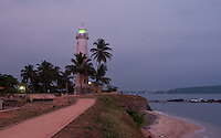 Twilight descends upon Galle Lighthouse and Fortress on the southern coast of Sri Lanka.