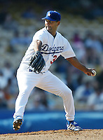 Omar Daal of the Los Angeles Dodgers pitches during a 2002 MLB season game at Dodger Stadium, in Los Angeles, California. (Larry Goren/Four Seam Images)