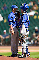 Starting pitcher Jordan Cooper #31 of the Kentucky Wildcats chats with catcher Michael Williams #35 during the game against the Utah Utes at Minute Maid Park on March 6, 2011 in Houston, Texas.  Photo by Brian Westerholt / Four Seam Images