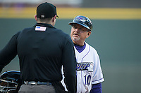 Winston-Salem Dash manager Tim Esmay (10) discusses a call with home plate umpire Randy Rosenberg during the game against the Potomac Nationals at BB&T Ballpark on April 30, 2015 in Winston-Salem, North Carolina.  The Nationals defeated the Dash 5-4..  (Brian Westerholt/Four Seam Images)