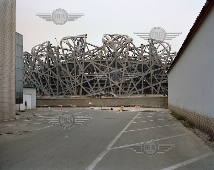 The construction site of the 2008 Olympic Games stadium, designed in the style of a bird's nest by architects Herzog & de Meuron. The stadium is being built with 36 km of unwrapped steel, with a weight of 45,000 tonnes.