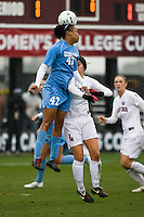 North Carolina forward Jessica McDonald (47) gets the header over the top of Stanford defender Alina Garciamendez (4). North Carolina defeated Stanford 1-0 to win the 2009 NCAA Women's College Cup at the Aggie Soccer Stadium in College Station, TX on December 6, 2009.