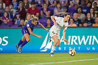 Orlando, FL - Saturday March 24, 2018: Utah Royals forward Kelley O'Hara (5) dribbles away from Orlando Pride forward Rachel Hill (15) during a regular season National Women's Soccer League (NWSL) match between the Orlando Pride and the Utah Royals FC at Orlando City Stadium. The game ended in a 1-1 draw.