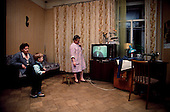 """Moscow, Russia<br /> Soviet Union<br /> December 15, 1991<br /> <br /> A family at home in central Moscow eating dinner.<br /> <br /> In December 1991, food shortages in central Russia had prompted food rationing in the Moscow area for the first time since World War II. Amid steady collapse, Soviet President Gorbachev and his government continued to oppose rapid market reforms like Yavlinsky's """"500 Days"""" program. To break Gorbachev's opposition, Yeltsin decided to disband the USSR in accordance with the Treaty of the Union of 1922 and thereby remove Gorbachev and the Soviet government from power. The step was also enthusiastically supported by the governments of Ukraine and Belarus, which were parties of the Treaty of 1922 along with Russia.<br /> <br /> On December 21, 1991, representatives of all member republics except Georgia signed the Alma-Ata Protocol, in which they confirmed the dissolution of the Union. That same day, all former-Soviet republics agreed to join the CIS, with the exception of the three Baltic States...."""