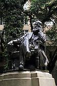 Petropolis, Brazil. Statue of Dom Pedro II sitting cross legged in a chair.