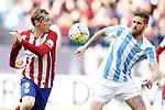 Atletico de Madrid's Fernando Torres (l) and Malaga CF's Raul Arbentosa during La Liga match. April 23,2016. (ALTERPHOTOS/Acero)