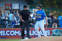 Home plate umpire Jake Bruner tries to keep Myrtle Beach Pelicans manager Steve Lerud (39) away from base umpire Mark Bass (not pictured  during the game against the Winston-Salem Dash at TicketReturn.com Field on May 16, 2019 in Myrtle Beach, South Carolina. The Dash defeated the Pelicans 6-0. (Brian Westerholt/Four Seam Images)
