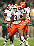 Illinois Fighting Illini defensive tackle Corey Liuget (93) and Illinois Fighting Illini linebacker Nate Bussey (18) celebrate after making a tackle during the 2010 Texas  Bowl football game between the Illinois  Fighting Illini and the Baylor Bears at the Reliant Stadium in Houston, Tx. Illinois defeats Baylor 38 to 14....