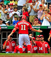24 May 2009: Washington Nationals' third baseman Ryan Zimmerman returns to the dugout after an Adam Dunn homer against the Baltimore Orioles at Nationals Park in Washington, DC. The Nationals rallied to defeat the Orioles 8-5 and salvage one win of their interleague series. Mandatory Credit: Ed Wolfstein Photo