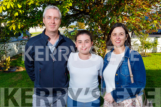 Faye Courtney graduating from Abbeydorney NS on Monday standing with her dad and mom Fergus and Tanya Courtney