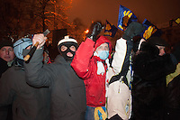 Armed group of protesters protecting the barricades in the government district. Kiev. Ukraine