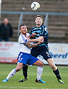 Peterhead's David Cox and Forfar's Darren Dods challenge for the ball.