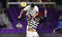 ORLANDO CITY, FL - JANUARY 31: Miles Robinson #12 of the United States goes up over Alvin Jones #16 of Trinidad and Tobago during a game between Trinidad and Tobago and USMNT at Exploria stadium on January 31, 2021 in Orlando City, Florida.