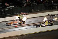Jul. 24, 2009; Sonoma, CA, USA; NHRA top fuel dragster driver Cory McClenathan (left) races alongside Morgan Lucas during qualifying for the Fram Autolite Nationals at Infineon Raceway. Mandatory Credit: Mark J. Rebilas-