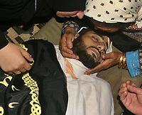 "Relative of the member of Sarya Alquds Brigads the wing army for Islamic Jihad Movement  Mahmoud al Haj  in the Nusayrat refugee camp, central Gaza Strip. who was killed by Israel army in westren al Burij Refugee camp 01 November 2007  ""photo by Fady Adwan"""