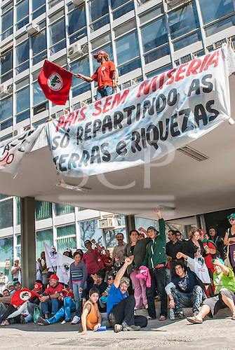 "Brasilia, Brazil. Landless Sem Terra Via Campesina protest in Brasilia, 23rd August 2011, in front of the ministry building (Ministerio da Fazenda). The banner reads ""Land without misery is only when the land and riches are shared out""."