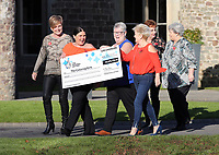 Pictured L-R: Julie Amphlett, Louise Ward, Sian Jones, Doreen Thompson, Julie Saunders and Jean Cairns with the check. Wednesday 08 November 2017<br /> Re: Presentation of hospital catering syndicate win £25m in Euromillions Jackpot at Hensol Castle, south Wales, UK. Julie Saunders, 56, Doreen Thompson, 56, Louise Ward, 37, Jean Cairns, 73, SIan Jones, 54 and Julie Amphlett, 50 all work as catering staff for Neath Port Talbot Hospital in south Wales.