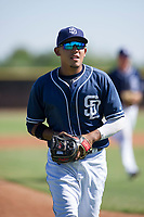 San Diego Padres third baseman Kelvin Melean (4) jogs off the field between innings during an Instructional League game against the Texas Rangers on September 20, 2017 at Peoria Sports Complex in Peoria, Arizona. (Zachary Lucy/Four Seam Images)