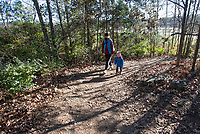 Cora Robson and her son Isaiah, 3, hike Sunday Nov. 15, 2020 at Kessler Mountain Regional Park in southwest Fayetteville. The 620 acre park has 13 miles of trails. Visit nwaonline.com/201116Daily/ and nwadg.com/photos. (NWA Democrat-Gazette/J.T.WAMPLER)