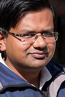 India, Dehradun.  Young Indian Man with Eyeglasses.