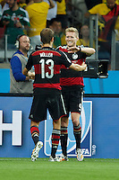 Andre Schurrle of Germany celebrates scoring a goal with Thomas Muller after making it 0-7