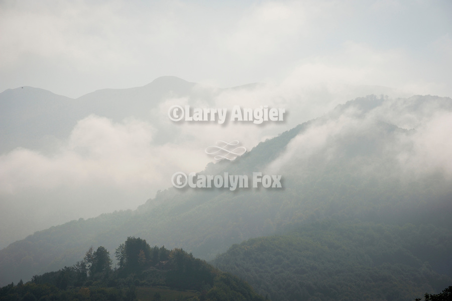 Cottages on the hillside, fog, rural Montenegro