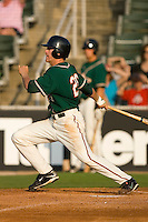 Kevin Mattison #28 of the Greensboro Grasshoppers follows through on his swing versus the Kannapolis Intimidators at Fieldcrest Cannon Stadium June 13, 2009 in Kannapolis, North Carolina. (Photo by Brian Westerholt / Four Seam Images)