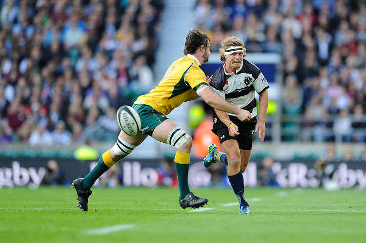 Nick Cummins of Barbarians chips ahead as Sam Carter of Australia challenges during the Killik Cup match between Barbarians and Australia at Twickenham Stadium on Saturday 1st November 2014 (Photo by Rob Munro)