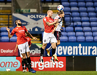 Bolton Wanderers' Lloyd Isgrove (right) competing with Salford City's Tom Clarke<br /> <br /> Photographer Andrew Kearns/CameraSport<br /> <br /> The EFL Sky Bet League Two - Bolton Wanderers v Salford City - Friday 13th November 2020 - University of Bolton Stadium - Bolton<br /> <br /> World Copyright © 2020 CameraSport. All rights reserved. 43 Linden Ave. Countesthorpe. Leicester. England. LE8 5PG - Tel: +44 (0) 116 277 4147 - admin@camerasport.com - www.camerasport.com