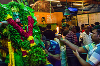 Worshipers Offering Prayers to Hindu God Hanuman,  Decorated with Garlands and Offerings, Sree Veera Hanuman Temple, Kuala Lumpur, Malaysia.