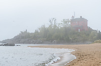 Morning fog along Lake Superior at the Marquette Harbor Lighthouse. Marquette, MI
